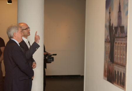 """Novi Sad mayor Milos Vucevic and US Ambassador in Serbia Kyle R. Scott in front of Topalski painting """"Liberty at the square of Liberty"""""""
